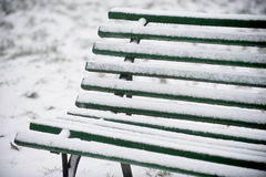 Snowed wooden bench Royalty Free Stock Photos