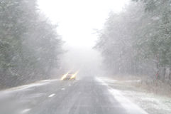 Snowfall. Journey in the foul weather Royalty Free Stock Photo