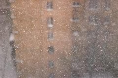 Snowfall abstract texture with building on the background royalty free stock image