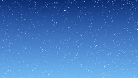 Snowfall against the blue sky seamless looping stock video
