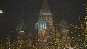 Snowfall in the background of Saint Basil`s Cathedral. stock footage
