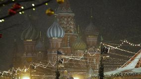 Snowfall in the background of Saint Basil`s Cathedral. stock video footage