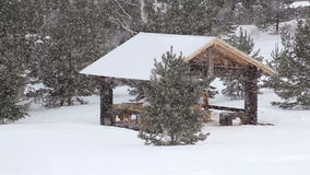 Snowfall on the background of wooden gazebo stock video footage