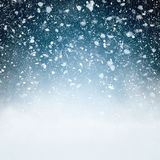 Snowfall with Blue Background Stock Photography