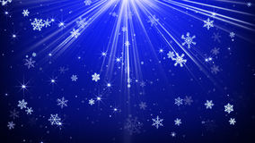 Snowfall in blue light rays abstract background Royalty Free Stock Photo