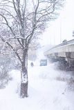 Snowfall at the bridge in the city Stock Image