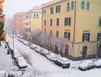 Snowfall on buildings in winter Stock Photography