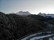 Snowfall in the Chugach mountains. Created by dji camera stock photo