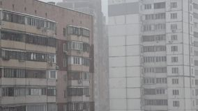 Snowfall in city stock footage