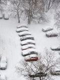 Snowfall in city and cars on parking Stock Images