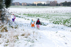 Snowfall in the city. Children in the snow. Snowfall in the city. Children for a walk in the snowy fields Stock Photos
