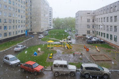 Snowfall in the city court. Russia Stock Photography