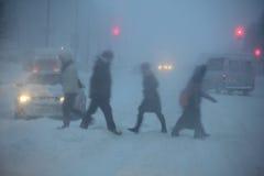 Snowfall in the city at dusk Stock Photo