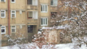 Snowfall In the City, Front Focused Slowmotion. Snow flakes falling down in front of the scene in ugly region stock video