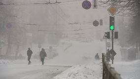 Snowfall in the city. Heavy snowfall in the city snowstorm drifts transport collapse stock video footage