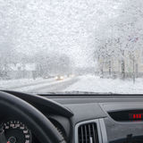Snowfall in city from inside car Royalty Free Stock Photos
