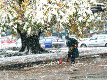 Snowfall in the city. A janitor cleans unexpectedly fallen snow in Dushanbe, Tajikistan Stock Photos
