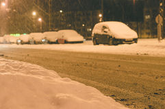 Snowfall in city, snowbound parking Stock Photography