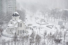 Snowfall in city Stock Image