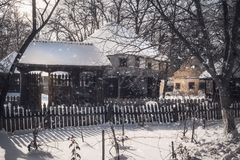 Snowfall in an old Romanian Village. Snowfall on cold winter day at the Village Museum in Bucharest, Romania. Winter holiday background concept Royalty Free Stock Photography