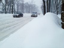 Snowfall covering roads Stock Images
