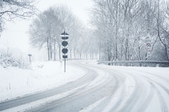 Snowfall on a curvy country road Stock Photos