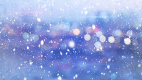Snowfall and defocused lights evening city Royalty Free Stock Image