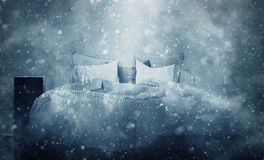 Snowfall effect over bed in room. 3D rendering of snowfall effect over bed in room for concept about winter season or Christmas holiday Stock Image