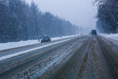 Snowfall and fog on winter highway Stock Photo