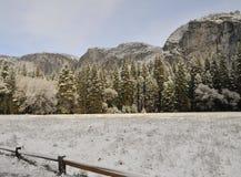 Snowfall on granit peaks Stock Photography