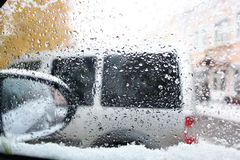 Snowfall motion cars Royalty Free Stock Photos