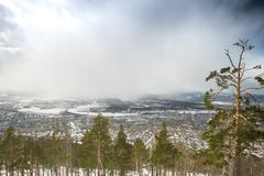Snowfall in the mountains on a sunny day royalty free stock photography