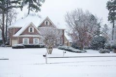 Snowfall on Nice Brick House Royalty Free Stock Photography