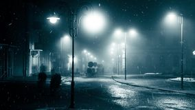 Snowfall in night city stock video footage