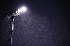 Snowfall at night with lantern light Stock Images