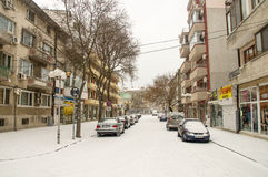 Snowfall in old street in Pomorie, Bulgaria stock images