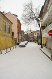 Snowfall in old street in Pomorie, Bulgaria stock photography