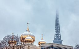 Snowfall over Holy Trinity Russian Orthodox Cathedral - Paris royalty free stock photography