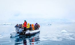 Snowfall Over The Boat With Frozen Tourists Drifting Among Icebe Royalty Free Stock Images