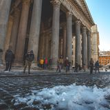 Snowfall on the Pantheon, Rome. Snow that remains on a sunny afternoon at the Pantheon in Rome, featuring tourists Stock Photos