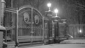 Snowfall in the Park at the gate stock video footage