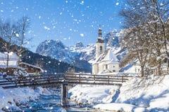 Snowfall in Ramsau, the parish church Saint Sebastian in winter, Ramsau, Berchtesgaden, Bavaria royalty free stock images