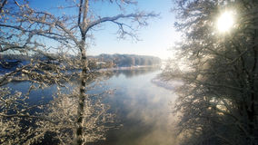 Snowfall оn the river. Winter landscape in the park. Stock Photography