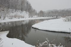 Snowfall on the river Stock Photos