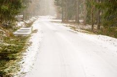 Snowfall on road Stock Photo