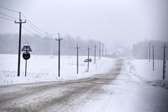 Snowfall and sleet on winter road. Ice snowy road. Winter snowst Royalty Free Stock Photos