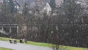 Snowfall in a small town. Snowfall in a small town on the background of private homes and bridge stock footage