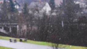 Snowfall in a small town. Blurring background stock video