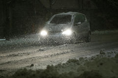 Snowfall on the streets of Velika Gorica, Croatia. VELIKA GORICA, CROATIA - JANUARY 13th, 2017 : Car driving on the road in the aggravated traffic due to strong Royalty Free Stock Photo
