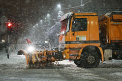 Snowfall on the streets of Velika Gorica, Croatia. VELIKA GORICA, CROATIA - JANUARY 13th, 2017 : Snowplow cleaning streets in the aggravated traffic due to Royalty Free Stock Photos
